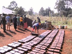 Making bricks for school building project kenya 2009