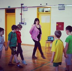 Kate O'Hara and kids point toes learning Irish dancing